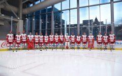 BSM's 2019-2020 boys' hockey team stands shoulder-to-shoulder on the ice.