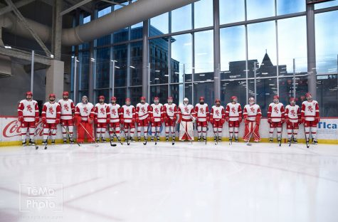 BSM's 2019-2020 boys' hockey team stands shoulder-to-shoulder on the ice.