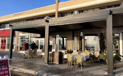 Large outdoor heaters stand tall at a Minnesota outdoor dining setup.