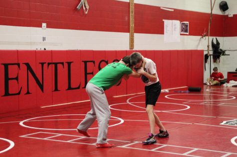 In a photo from the 2018-2019 season, two BSM wrestlers practice on the mats.