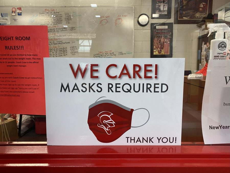 A+sign+outside+of+Athletic+Director+Jerry+Pettinger%27s+office+reminds+students+and+visitors+that+masks+are+required+at+all+times.