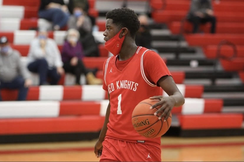 """Daniel """"Shifty"""" Ijadimbola, takes the ball down for the Red Knights."""