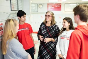 In a photoshoot from last year, BSM Principal Dr. Susan Skinner talks with students in the hallway. Now, Skinner plans her departure from BSM.