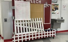Students who take first place in all their rounds at speech tournaments have the honor of signing the picket fence.