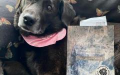 Kaia Preus's dog Cleo poses with The War Requiem