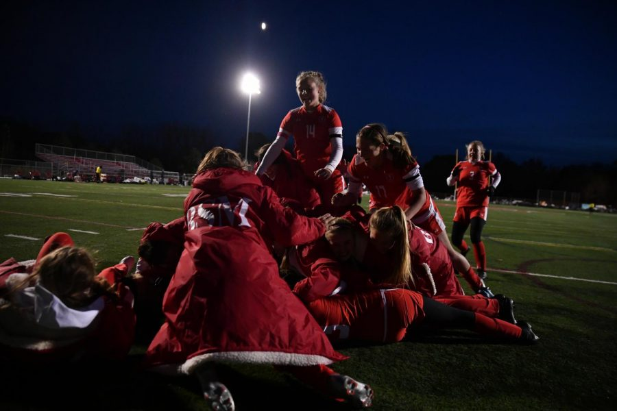 The girls soccer team celebrates a victory on the turf..
