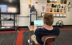 Senior George Wolfe strengthens his skills in Tetris while Mrs. Joseph talks