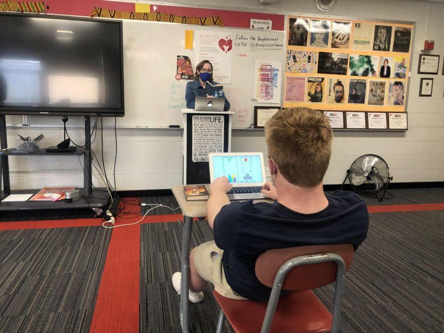 """Senior George Wolfe strengthens his skills in Tetris while Mrs. Joseph talks """"Frankenstein"""""""