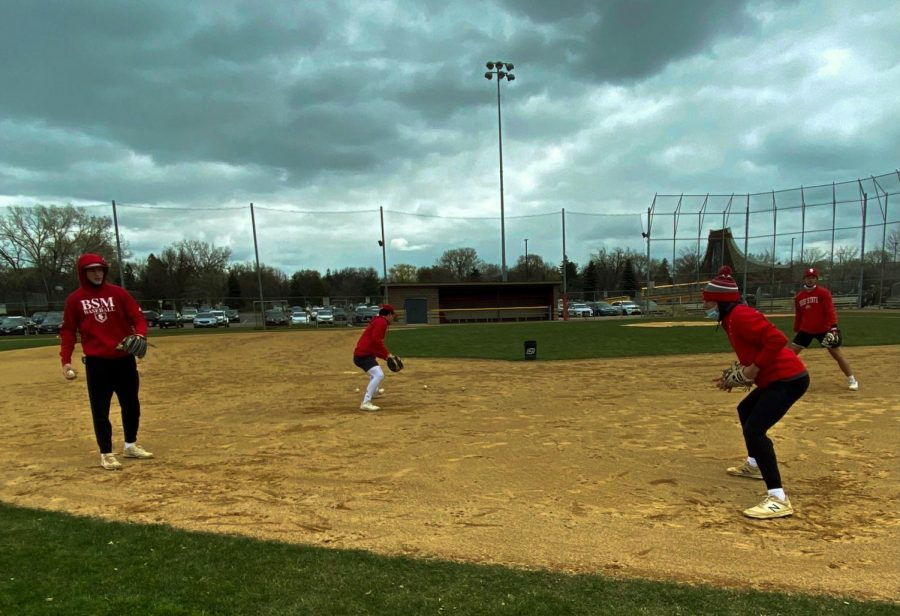 Out on the field, Red Knights participate in a game of catch to prep for the season.