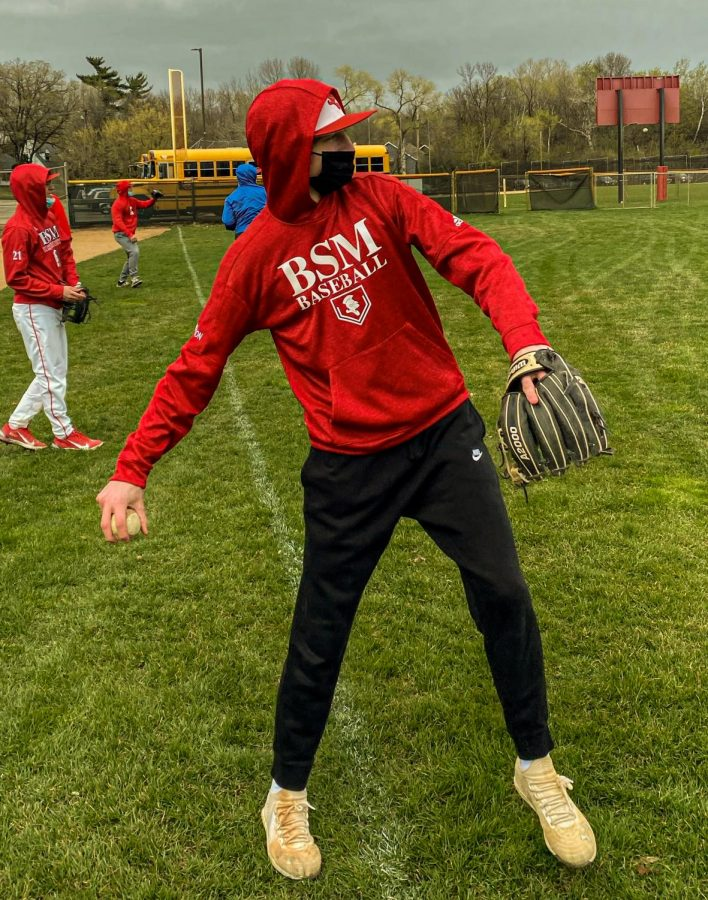 Before the season began, students practiced throwing out on the field.