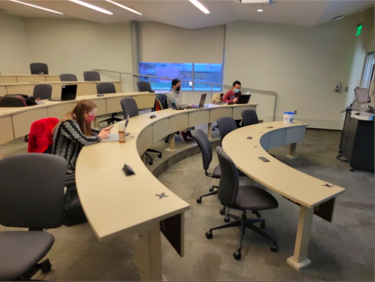 In a sparsely populated classroom, USD students remain COVID-safe with social distancing and masking.