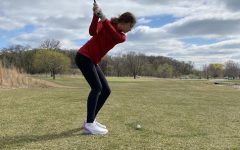Golfer Audrey Peterson prepares for her next match.