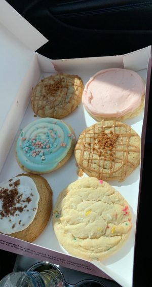 Six tasty Crumbl Cookies display some of the various possibilities this new cookie establishment has to offer.