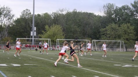 Sophomore Izzy Garvin chases SLP during Tuesday night