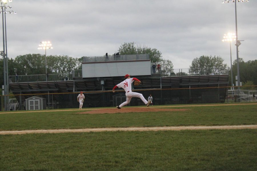 Owen Plourde pitches for the Red Knights.
