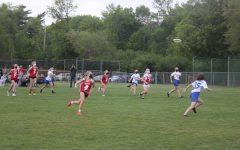 Seniors Ava Keller and Lauren Palmer run after the frisbee.