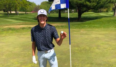 Freshman Charlie Moen grins while showcasing his accomplishment.