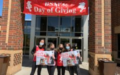 Students stand outside BSM's main doors to celebrate today's Day of Giving.