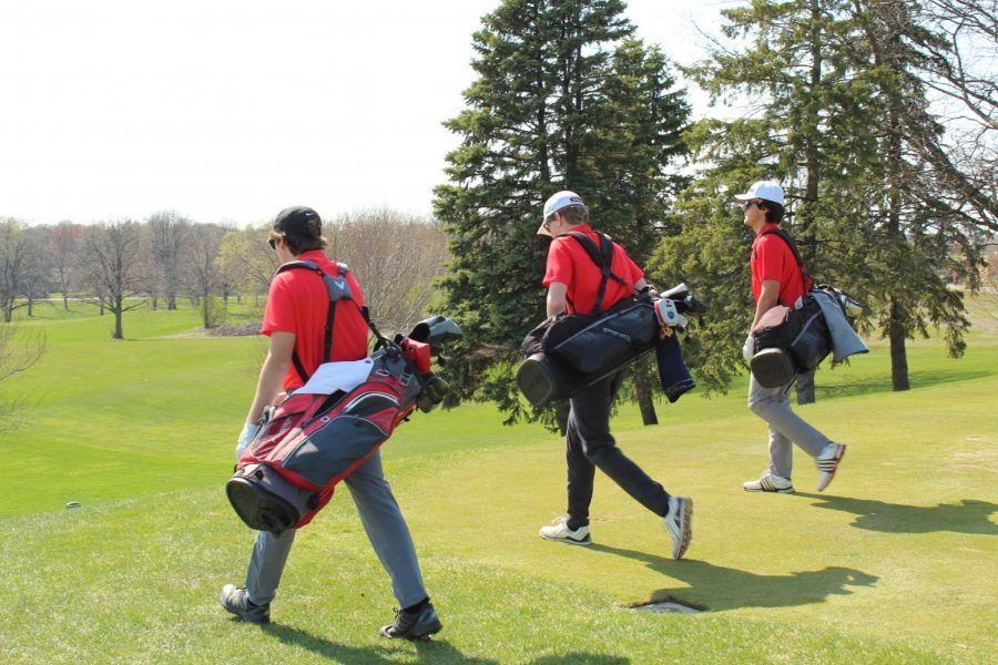 The boys' varsity golf team enters the course at Meadow Brook for practice.