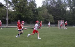 The Red Knights sprint after one another at practice.