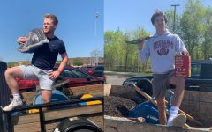 Senior George Wolfe of Good Knight Landscaping and senior Simon Goodmanson of Lucid Landscaping pose with their equipment.