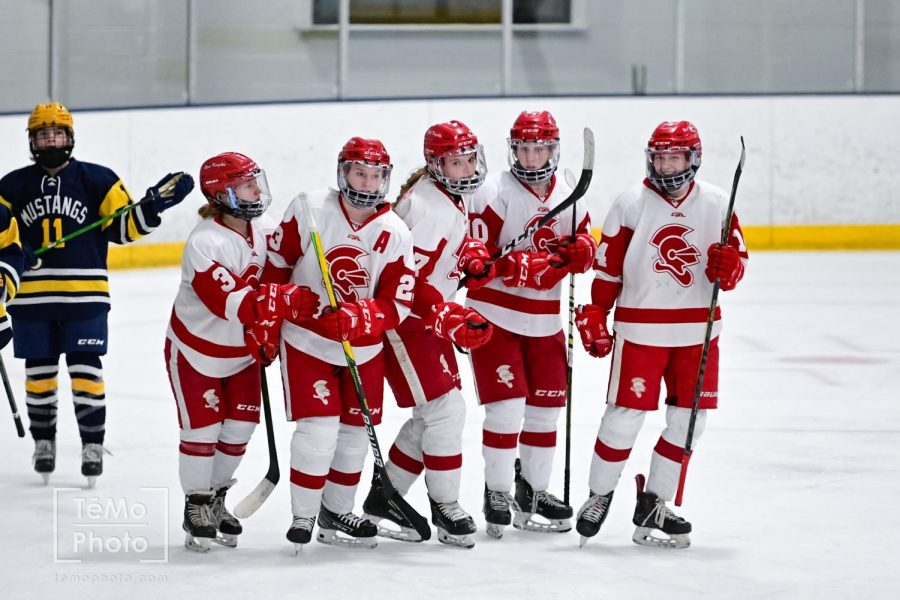 Former captains Olivia Haag and Maya Jones celebrate a goal with the new captains Emma Peschel, Emma Hoen, and Sophie Melsness.