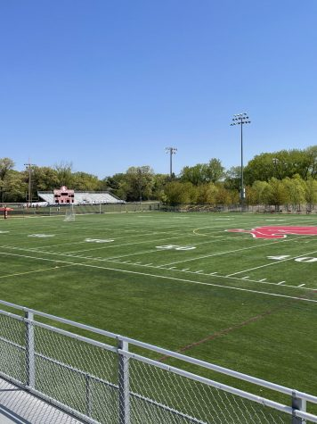 The sun shines on the bright Red Knight head of the football field. Next year, for first time in over 20 years, a new coach will fight for victory with the Red Knights.