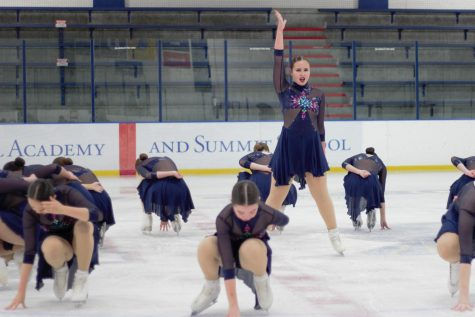 Senior Anna Medina strikes a pose during a figure skating competition.