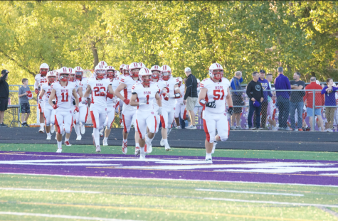 Red Knights storm onto the field to take on the Chaska Hawks.