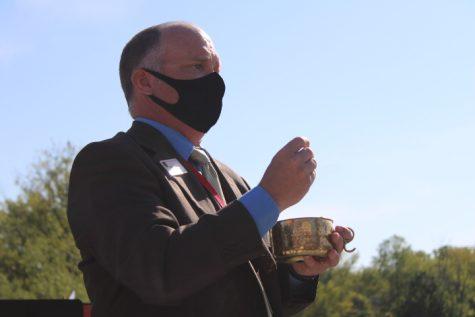 Mr. Weingartz offers communion at BSMs first outdoor Mass.