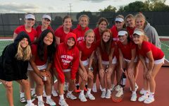 The BSM girls tennis team poses for a picture post win.