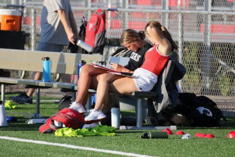 Bailey Skahan and Cassi Gonyea work hard on the bench during the girls soccer game.