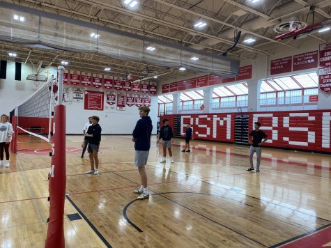 Wellness students enjoy a fun game of volleyball as a a productive mental and physical escape from academic activities.