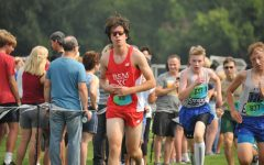Senior Owen Plourde competing at his Cross Country Meet.