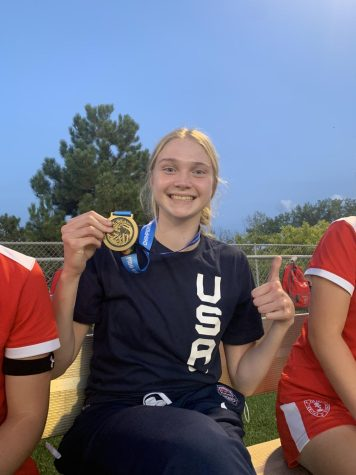 Dual-sport athlete Olivia shares her USA Basketball gold medal with her soccer teammates after returning from Mexico.
