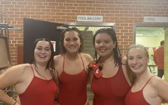 Senior swimmers celebrate after completing their relay in Tuesday nights swim meet.