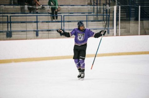 Phillips celebrating on the ice after a goal in a BEL game.